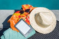 Free Black Amazon Kindle Tablet Near Brown Drawstring Sun Hat Royalty Free Stock Image - 126179306