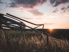 Free Grey Steel Farm Machine On Field During Orange Sunset Royalty Free Stock Image - 126179316