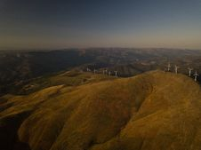 Free Aerial View Of White Turbines On Green Grass Hills Royalty Free Stock Photography - 126179407