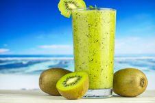 Free Kiwi Fruit Beside Drinking Glass Filled With Kiwi Shake Stock Images - 126179464