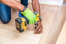 Free Person Holding Dewalt Cordless Hand Drill Royalty Free Stock Image - 126179476