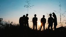 Free Silhouette Group Of People Standing On Grass Field Royalty Free Stock Image - 126179516