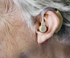 Free Person Wearing Hearing Aid Stock Photo - 126179530