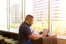 Free Man Sitting In Front Of His Laptop Stock Photography - 126179572