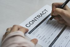 Free Person Signing Contract Paper Royalty Free Stock Photography - 126179587