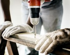 Free Repairman Doing Drilling Royalty Free Stock Images - 126179609