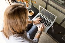 Free Person Sitting While Typing On Gray Laptop Stock Photo - 126179620
