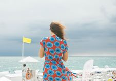 Free Woman In Red And Blue Floral Dress Standing Near Body Of Water Stock Images - 126179754
