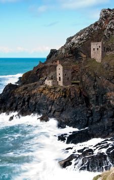 Free Two Gray Brick Watchtower On Cliff Near Sea At Daytime Stock Photography - 126179942