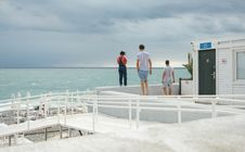 Free Three People Standing On White Surface Near Body Of Water Royalty Free Stock Images - 126179949