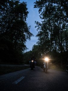 Free Two Men Riding Motorcycle On Road During Nighttime Stock Photos - 126180003
