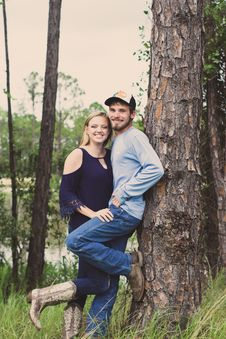 Free Couple Taking Photo Beside A Tree Stock Image - 126180151