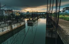 Free Photo Of Metal Bars On Water Under Dark Sky Stock Photography - 126180182
