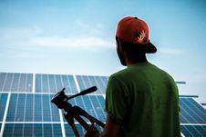 Free Man Facing Solar Panels Royalty Free Stock Photo - 126180235