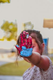 Free Girl Hand With Red And Blue Paint Stock Photography - 126180342