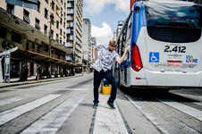 Free Man Dancing On Pedestrian Crossing Near Bus Royalty Free Stock Photo - 126180545