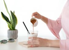Free Woman Pouring Honey On Desert Stock Image - 126180711