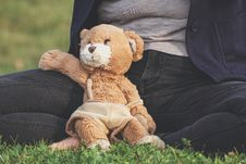 Free Brown Teddy Bear Toy Leaning On Person Royalty Free Stock Image - 126180826