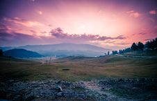 Free Green Grass Field Near Mountains Under Golden Hour Royalty Free Stock Photography - 126180827