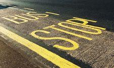 Free Bus Stop Printed On Asphalt Road Stock Image - 126180881