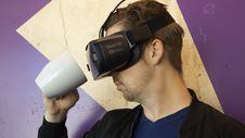 Free Man Wearing Virtual Reality Headset And Holding A Mug Stock Images - 126180934