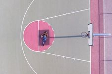 Free Woman Lying On Basketball Free Throw Line Royalty Free Stock Photography - 126180977