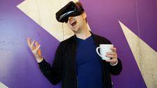 Free Man Wearing Black Virtual Reality Headset While Holding White Mug Royalty Free Stock Photography - 126181097