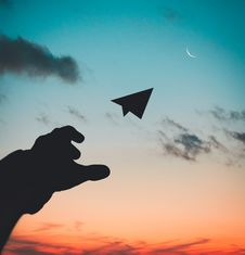 Free Silhouette Photo Of Man Throw Paper Plane Stock Photography - 126181122