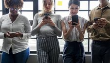 Free Three Women Standing Near Man Holding Smartphones Royalty Free Stock Photography - 126181127