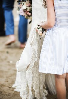 Free Girl In White And Blue Dress Holding Wedding Dress Of Woman Stock Images - 126181304