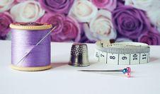 Free Spool Of Purple Thread Near Needle Thimble And Measuring Tape Stock Image - 126181441