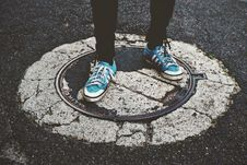 Free Person Standing On Manhole Cover Royalty Free Stock Photo - 126181455