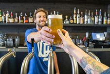 Free Man Handing A Person A Glass Of Beer Stock Image - 126181731