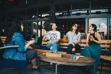Free Four Women Chatting While Sitting On Bench Stock Image - 126181881