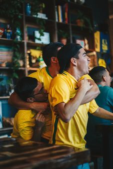 Free Three Men Wearing Yellow Shirt Embracing Each Other Royalty Free Stock Photo - 126181895