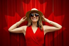 Free Woman In Red Sleeveless Dress With Canada Flag Printed Background Royalty Free Stock Image - 126182046
