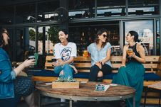 Free Four Women Sitting On Bench In Storefront While Drinking Alcoholic Beverages Royalty Free Stock Photos - 126182268