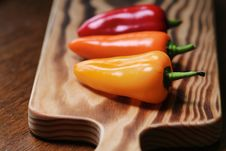 Free Photo Of Three Chili Peppers Stock Photos - 126183093