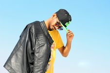 Free Man Holding His Black And Green Flat-brimmed Cap Stock Photography - 126183112