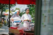 Free Two Women Buying Street Food Royalty Free Stock Image - 126183566