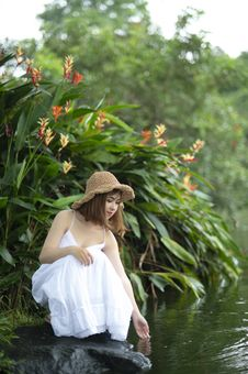 Free Woman Wearing White Dress Squatting Near Body Of Water Near Plants Stock Images - 126184014