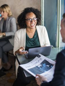 Free Woman Sitting On Chair Facing Man Holding Newspaper Stock Photos - 126184043