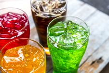 Free Four Assorted-flavored Drinks In Clear Drinking Glasses Stock Photography - 126184192