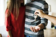 Free Person Giving Keys On Man Stock Photography - 126184212