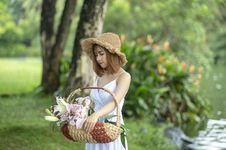 Free Photo Of Women Carrying Basket With Pink Petal Flower Stock Photo - 126184270