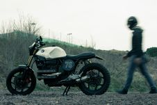 Free Man Standing Near Black And White Bmw Standard Motorcycle Stock Image - 126184461