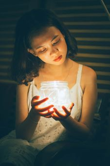 Free Woman Holding Decorative Jar With String Lights Stock Images - 126184474