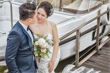 Free Newly Wed Couple Standing On Brown Wooden Dock Near Boat Stock Image - 126184921