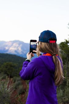 Free Woman Holding Smartphone While Taking Picture Of Mountain Royalty Free Stock Photos - 126185038