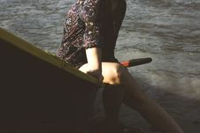 Free Woman Wearing Black And Red Paisley Tops Sitting Down On Boat Near Body Of Water Royalty Free Stock Images - 126185069